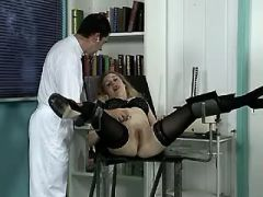 Pregnant blonde in stockings spoiled by doctor
