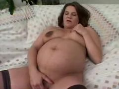 Pregnant chick in stockings throats strong cock