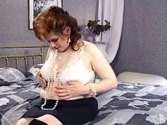 Redhead pregnant girl with big tits shows belly