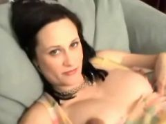 Lonely pregnant girl plays with wet pussy on sofa