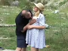 Man caress pregnant milf in nature