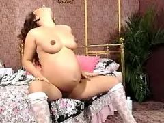 Pregnant beauty caress oiled big belly