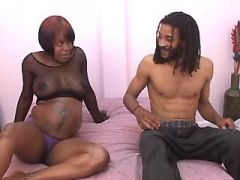 Pregnant ebony girl throats black cock in bed