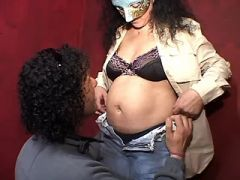 Pregnant brunette mature in mask spoils man in bed