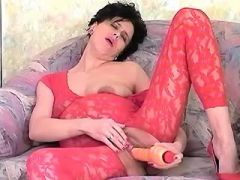 Pregnant lady in red lingerie plays with big dildo