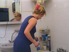 Hot blonde pregnant girl relaxes in her shower