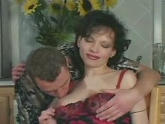 Chesty pregnant beauty spoiling man on kitchen