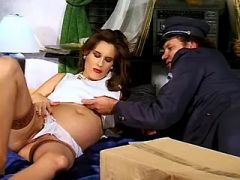 Brunette pregnant girl sucks hard cock of mailman