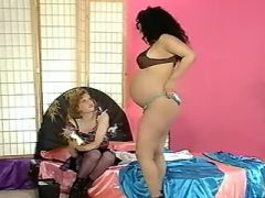 Chesty lesbian spoils ethnic pregnant babe in bed
