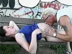 Man licks and hard fucks brunette preggo on bench
