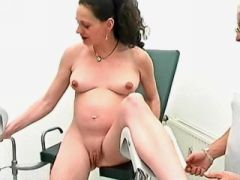 Curly preggo girl gets cum on belly in groupsex