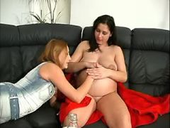 Slut spoils pregnant brunette girl on leather sofa