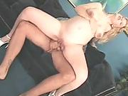 Massive titted blonde pumps on top of her lovers rock hard cock on the couch
