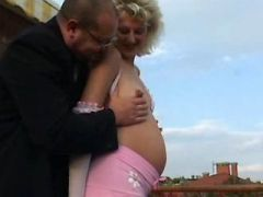 Pregnant girl sucks cock of old man on terrace