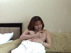 Asian preggo with big tits plays with hairy pussy
